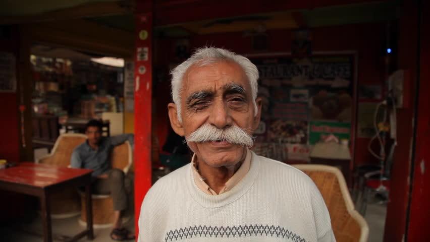PUSHKAR, INDIA - DECEMBER 22 : Indian man posing in the street on December 22, 2014 in Pushkar, India