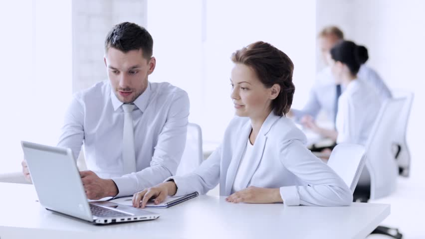 Group of business people having a meeting | Shutterstock HD Video #15657151