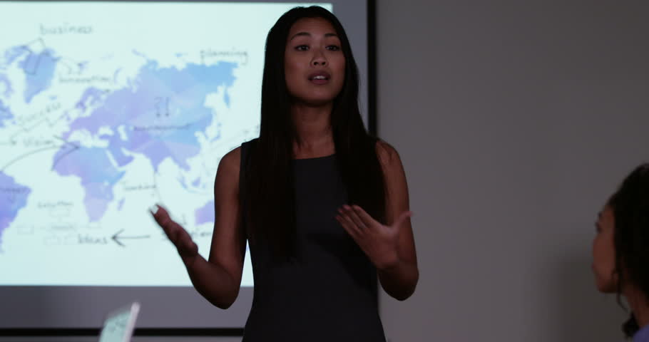 4k, An attractive young Asian female team leader presenting a financial report to his team. Slow motion. | Shutterstock HD Video #15689269