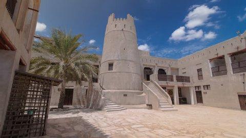 AJMAN, UAE - SEPTEMBER 14: Historic fort at the Museum of Ajman timelapse hyperlapse with blue cloudy sky, United Arab Emirates 4K