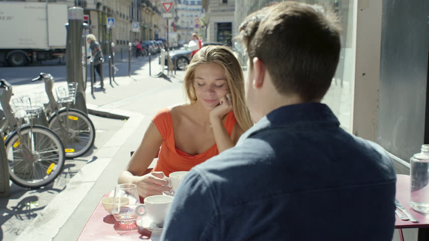 Couple having a date at cute little cafe Paris, France | Shutterstock HD Video #15694141