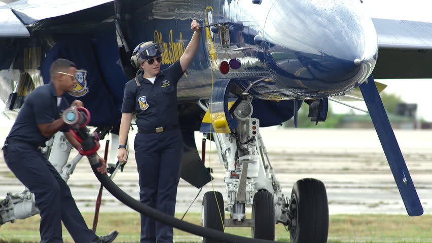 NORTH KINGSTOWN, RHODE ISLAND - CIRCA JUNE 2014:  Navy Blue Angels demonstration team in F18 Hornet fighter jets. Ground crew fueling a jet.