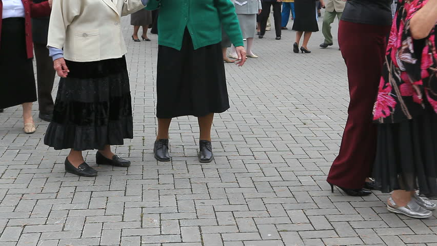 Active seniors dancing in the open air in the house of retired