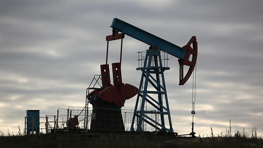 Oil pump over sunrise