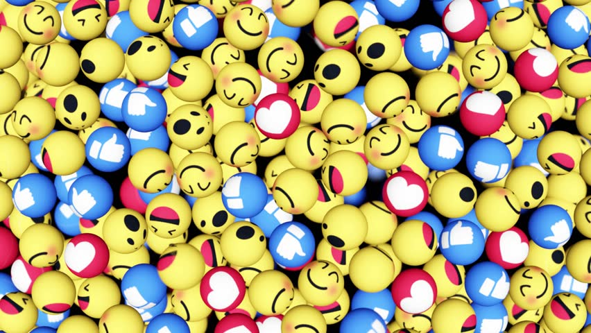 Facebook like button and empathetic emoji in the form of balls are falling on the surface. Social networking service. Matte included, ready for compositing, isolated on black. 3D render. Editorial.