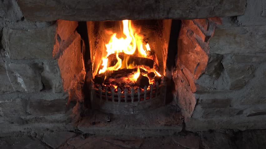 Close Up Of Open Old Wood Fireplace Lit With Flames And Log At ...