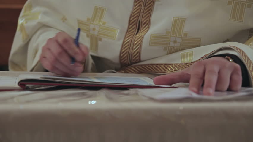 the Priest Wrote Something in a Notebook