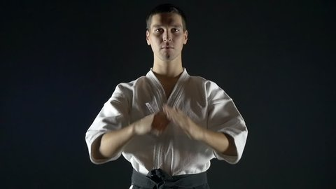 karate with a black belt makes a bow, slow motion