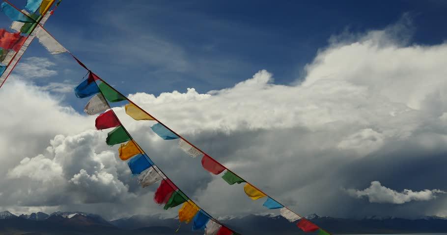 4k huge clouds mass rolling over lake namtso & Tanggula snow mountain peak,tibet mansarovar,pray flag in wind,Tibet's second largest lake,is the third largest saltwater lake in China.gh2_09497_4k | Shutterstock HD Video #15767101