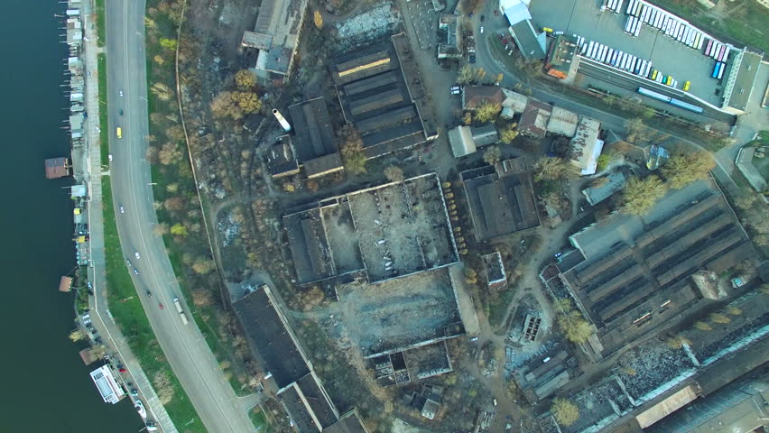 Flying over the abandoned plant at sunset. Aerial survey 4k | Shutterstock HD Video #15781021
