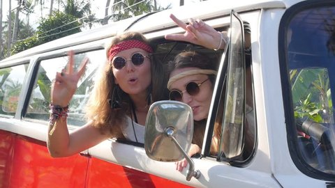 Hippie Girls Travel in Van on a Road Trip with Peace Sign