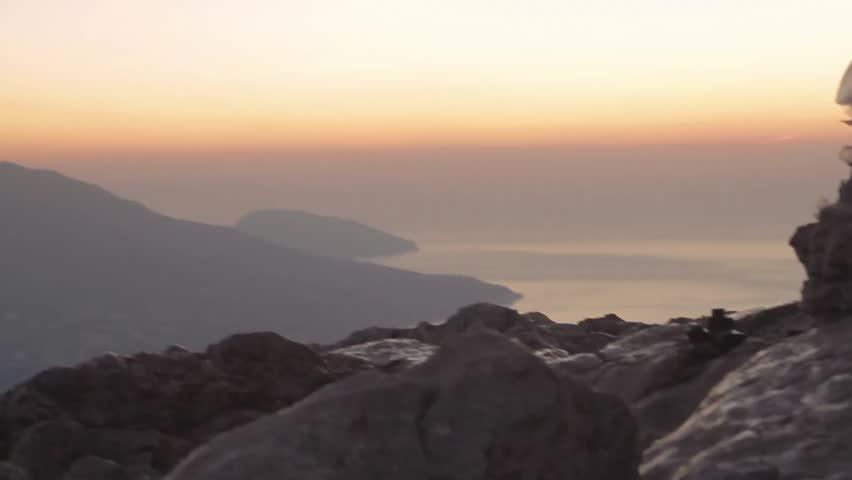 Ayu Dag Mountain view from the top of Ai Petri mountain during sunrise. Handheld shot, rack focus. Crimea, Ukraine