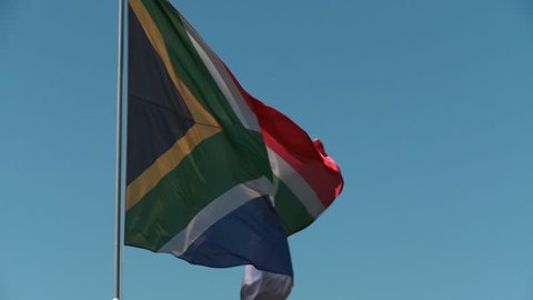 Medium shot of South African flag blowing in the wind