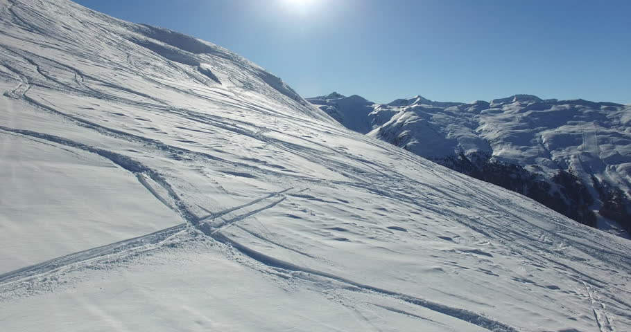 Aerial - winter alps, snow mountain Livigno, background, in a sunny day
