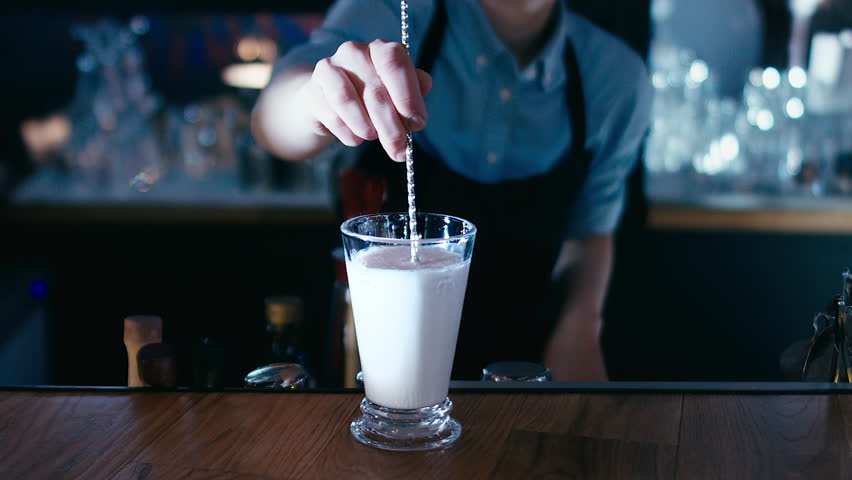 Barista stirring a milkshake. 4K cinemagraph - motion photo seamless loop