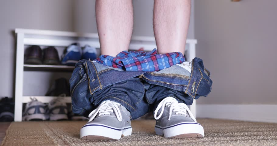 A man exposes himself by lowering then raising his pants and underwear.