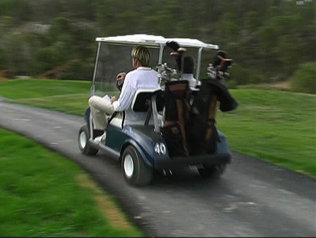2 Caddies speeding to the next tee