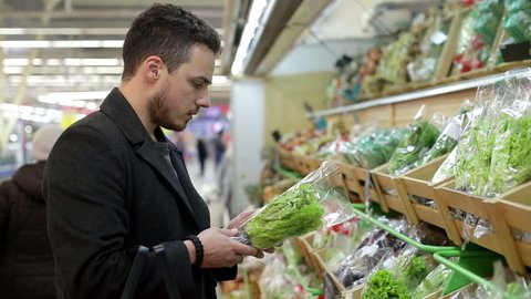 Man chooses products in the supermarket