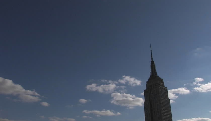 NEW YORK CITY, NY - CIRCA 2009: High clouds pass the Empire State Building circa 2009 in New York.