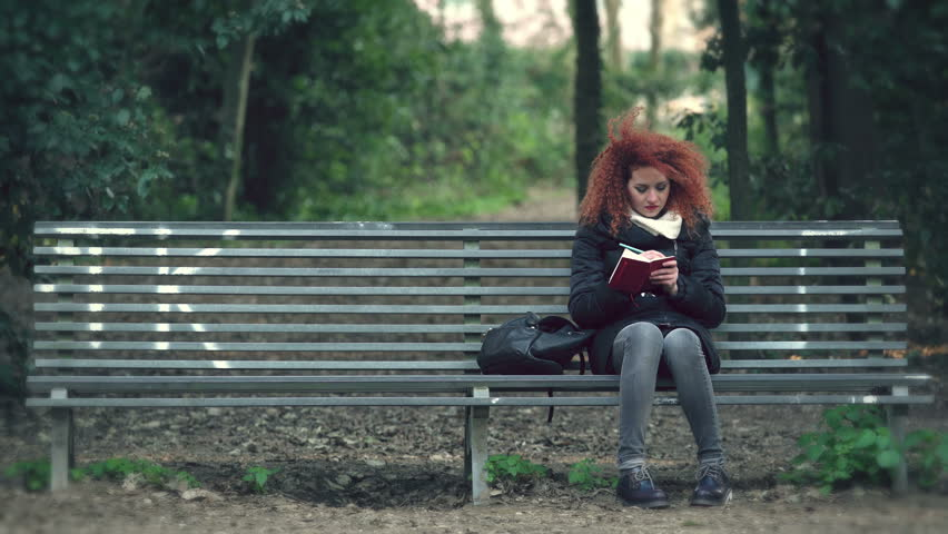 Amusing redhead on bench entertaining phrase