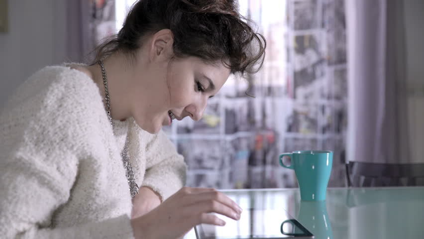 Woman amused by a funny video on the web, cup of tea | Shutterstock HD Video #15971701