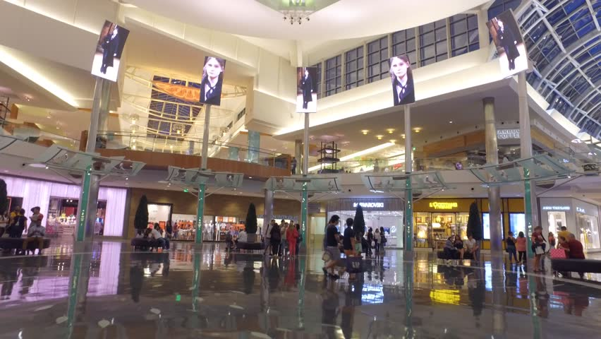 ORLANDO - APRIL 8: Walking through Mall at Millenia which is an upscale indoor shopping mall opened in 2002 located at 4200 Conroy Rd April 8, 2016 in Orlando FL, USA