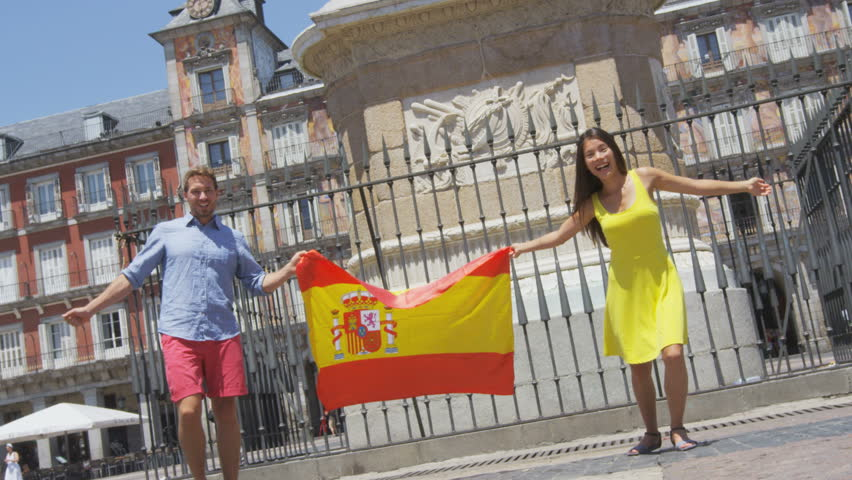 Madrid People Showing Spain Flag On Plaza Mayor Cheerful And Happy - Famous people from spain