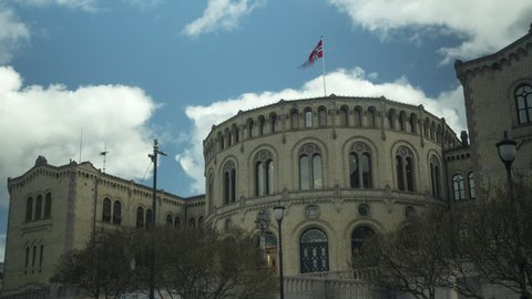 Stormy clouds over Stortinget, Norwegian government building in Oslo, capital og Norway, time lapse to blur out distractions