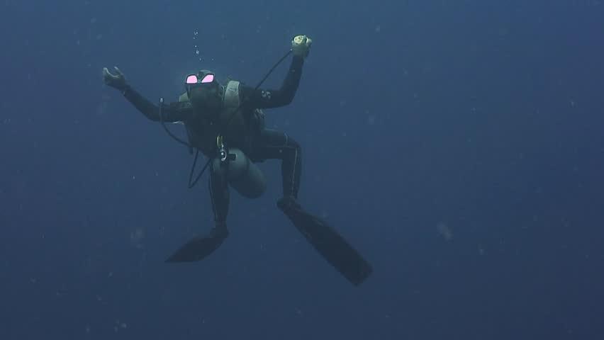 Scuba Diver blowing circular bubbles. | Shutterstock HD Video #15984685