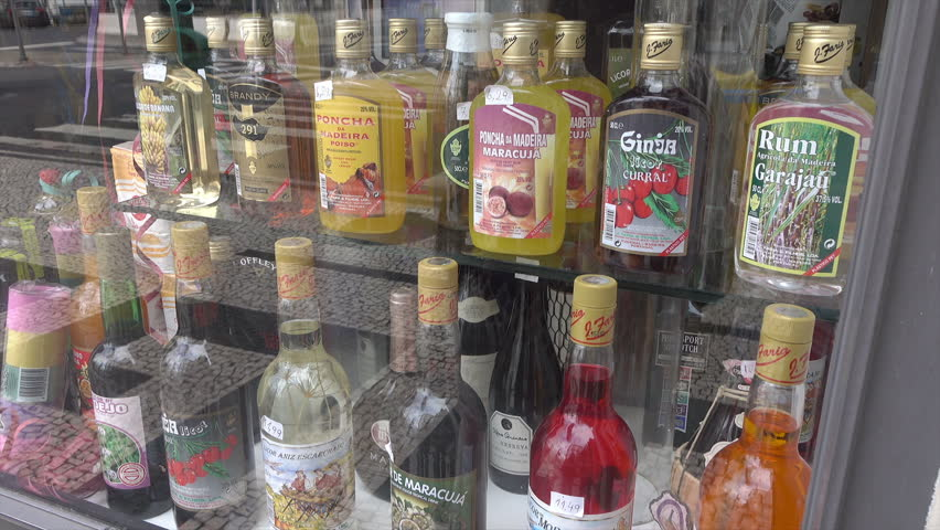 FUNCHAL, MADEIRA/PORTUGAL - JANUARY 23, 2016: Bottles of Madeiran wines and spirits in shop window in downtown Funchal. Madeira is world famous for its sweet maderian wines.