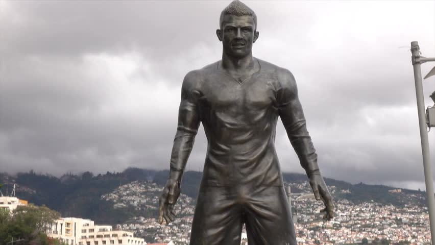FUNCHAL, MADEIRA/PORTUGAL - JANUARY 23, 2016: Statue of Cristiano Ronaldo on island where he was born. Ronaldo is often ranked the best football player in the world.