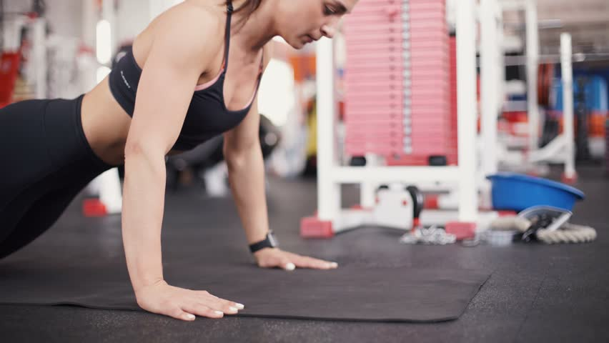 Brunette Woman at Gym Push Stock Footage Video (100% Royalty-free) 16014331  | Shutterstock