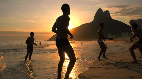 Rio de Janeiro, Brazil - December 19, 2015: Locals playing ball game at sunset at Ipanema beach in Rio de Janeiro, Brazil.