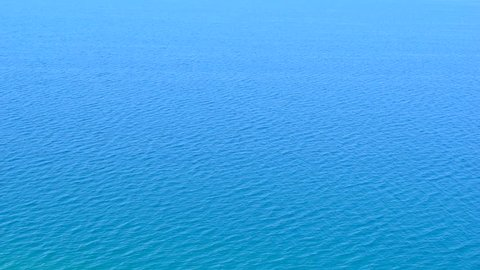 Sea, seascape, ocean, nature background. Idyllic seascape: clean water, waves, blue sky, horizon. Sea water surface, sea water texture, nature, resort, sea vacation full hd video background.