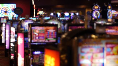 A shot of out of focus lights from a slot machines in a casino