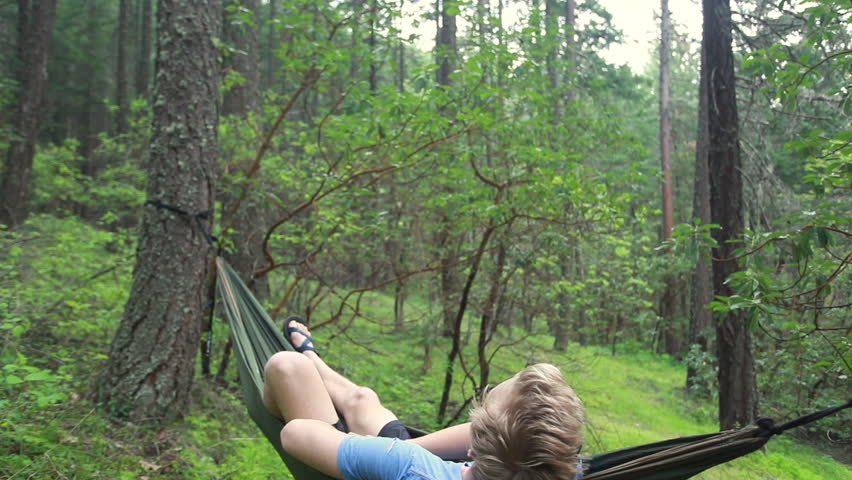 A looping video of a person relaxing in a hammock