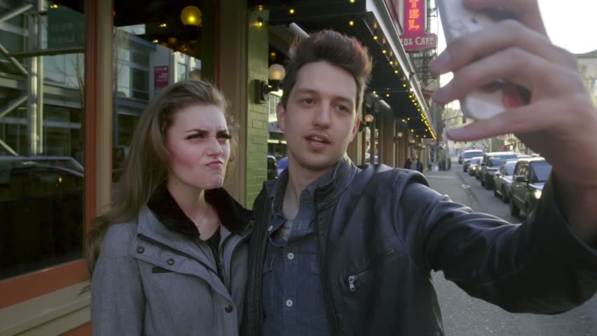 Young couple taking selfies make funny faces for the camera | Shutterstock HD Video #16131391