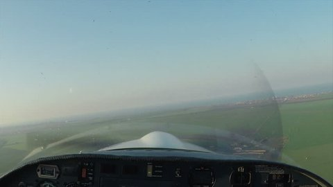 Point of view of a small airplane flying at sunset