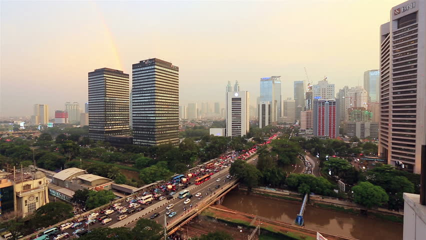 JAKARTA, INDONESIA - APRIL 17, 2016: Traffic rushes in the central business district of Jakarta in Indonesia capital city. Shot in real time during sunset.