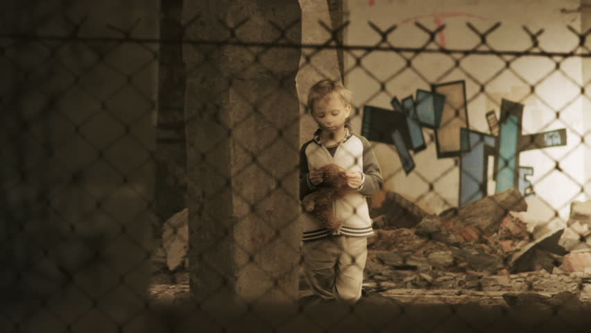 Homelessness. Lonely child in slums. Orphan. Refugee camp. Static shot. Canon 7d, HD 1080 25p Clip ID: boy9_HD