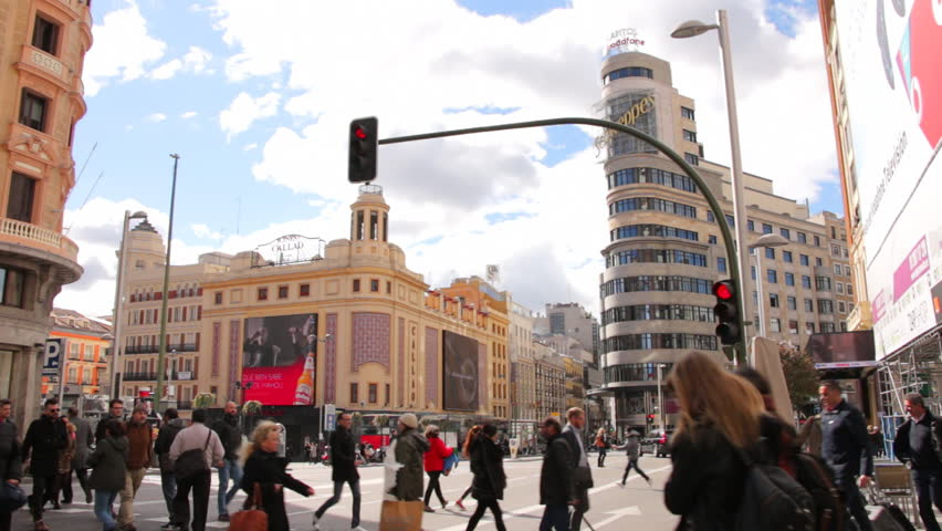 MADRID, SPAIN 10 MARCH 2016: People crossing the Gran Via street to Plaza Callao in Madrid, Spain. City pedestrian traffic on a Callao Square and Gran via in central Madrid
