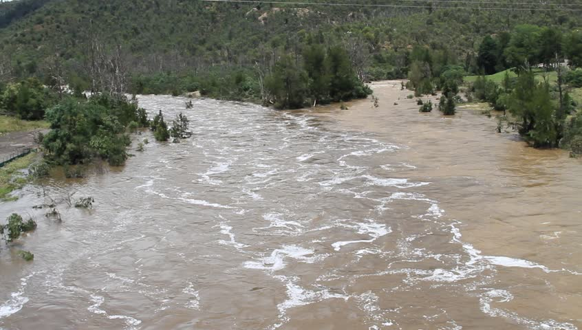 Cotter River flooding after torrential rainfall.