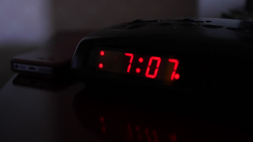 alarm clock going off at 5 30. a man sets the time on digital alarm clock 4k stock footage clip going off at 5 30 l
