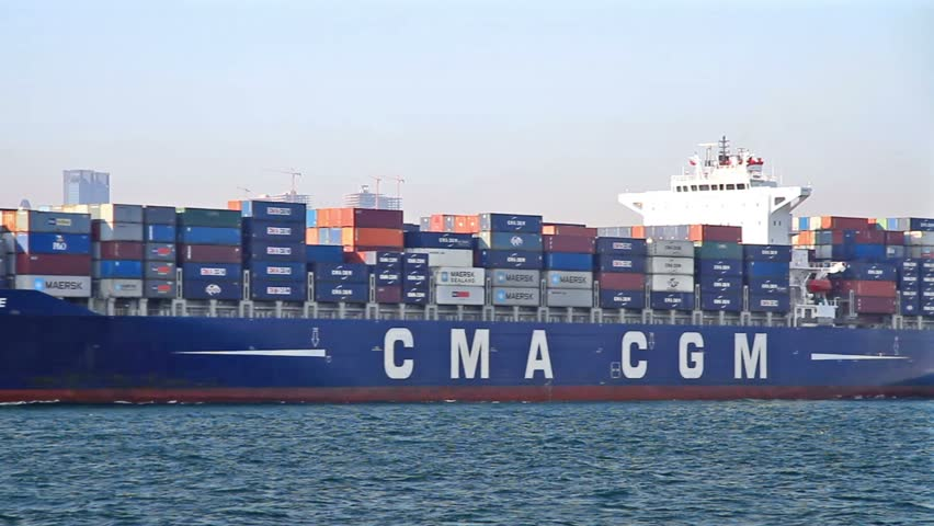 ISTANBUL - SEPTEMBER 24: Cargo Ship, Corneille (IMO: 9409170, Liberia) sails with full of containers in Bosporus on September 24, 2011 in Istanbul. 50,000 ships pass through the Straits every year.