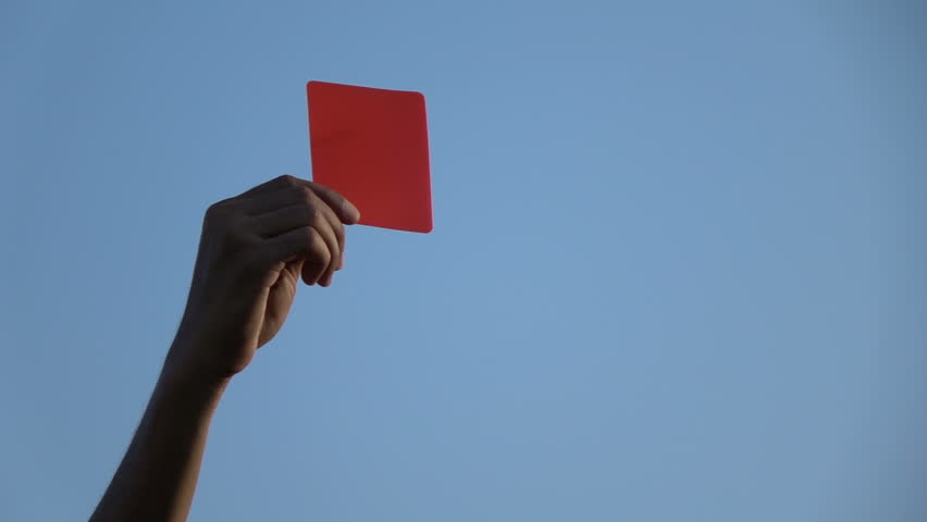 Football referee showing the red card, slow motion.