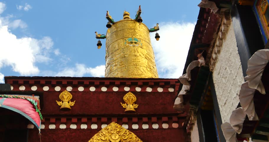 4k closeup of The Jokhang Temple In Lhasa,Tibet,white clouds in blue sky. gh2_09671_4k