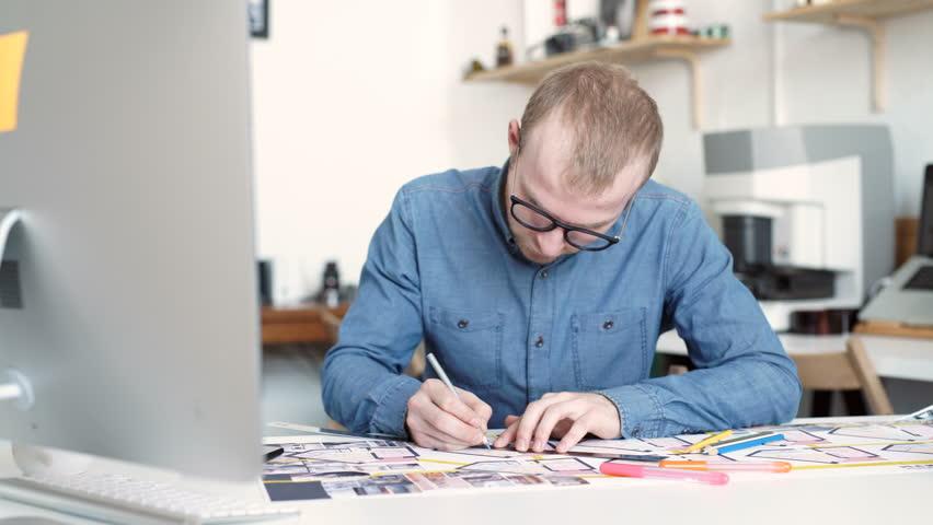 Stock video of stylish architect working on blueprint 16296574 visually similar footage malvernweather Gallery
