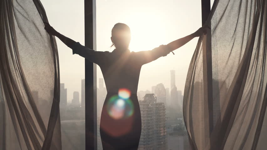 Young businesswoman unveil curtain and looking out of window  | Shutterstock HD Video #16318348