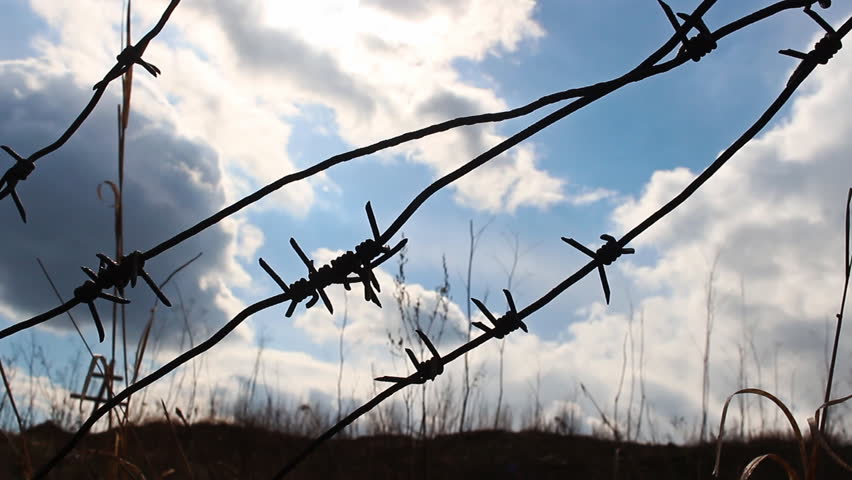 Stock video of prison barbed wire fence at sunset. | 30681682 ...