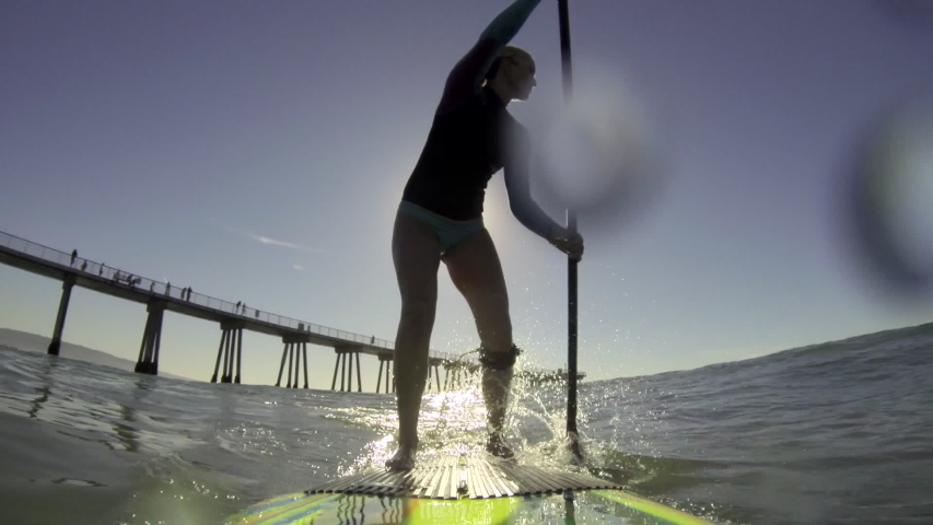 POV of a woman sup stand-up paddleboard surfing at the beach. - Model Released - filmed at 59.94 fps - Clip is HD 1920 x 1080 | Shutterstock HD Video #16393471
